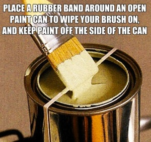 Rubber band on paint can to wipe brush on